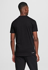 KARL LAGERFELD - IKONIK OUTLINE  - Print T-shirt - black - 2