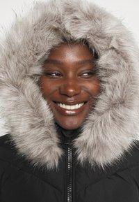 Tommy Hilfiger - PADDED COAT - Winter coat - black - 4