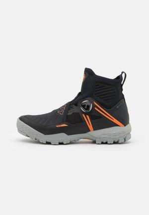 DUCAN - Hiking shoes - black/vibrant orange