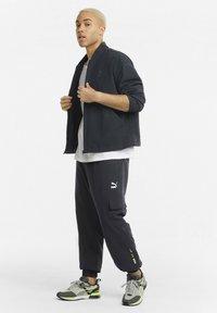 Puma - Trousers - black - 1