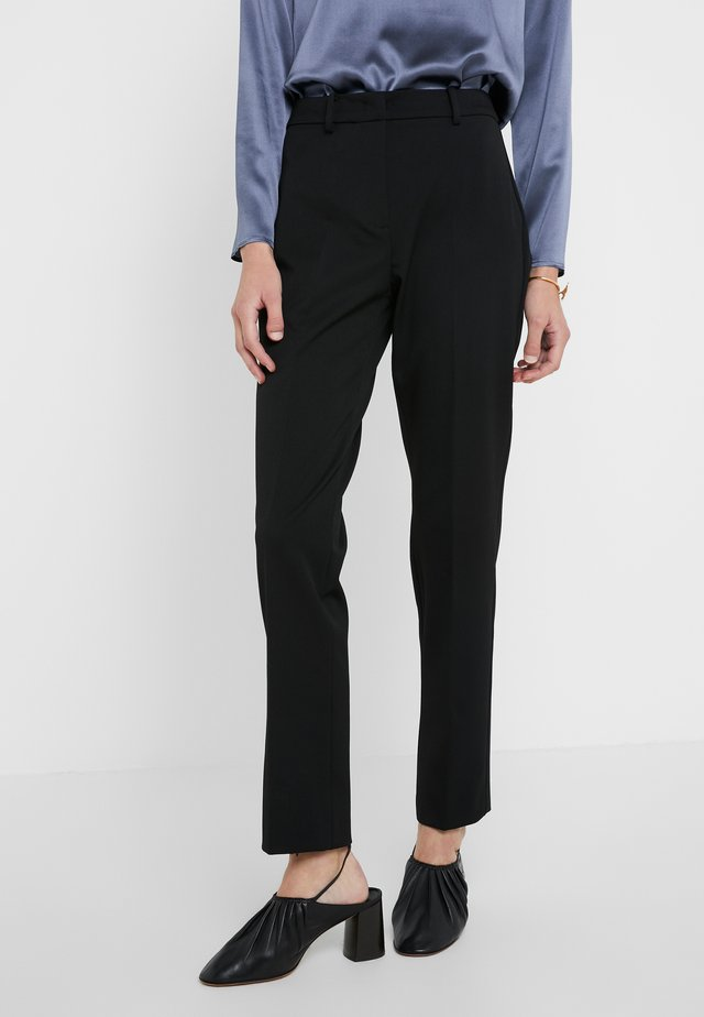 MADRE - Trousers - schwarz