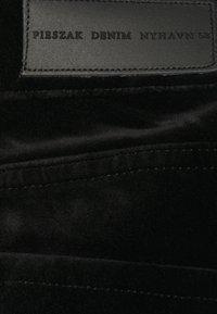 Pieszak - MARIJA FLARE  - Trousers - black - 2