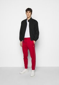 Polo Ralph Lauren - LUX TRACK - Pantalones deportivos - red - 1