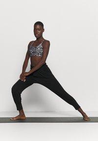 Deha - YOGA PANTS - Tracksuit bottoms - black - 1