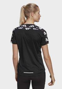 adidas Performance - OWN THE RUN CELEBRATION T-SHIRT - Print T-shirt - black - 2