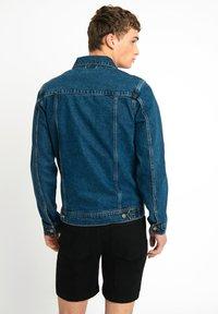 Urban Threads - LDN DNM STONE WASHED BLUE DENIM TRUCKER JACKET - Denim jacket - dark blue - 1