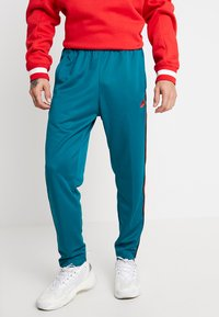 Nike Sportswear - PANT TRIBUTE - Tracksuit bottoms - geode teal/university red - 0