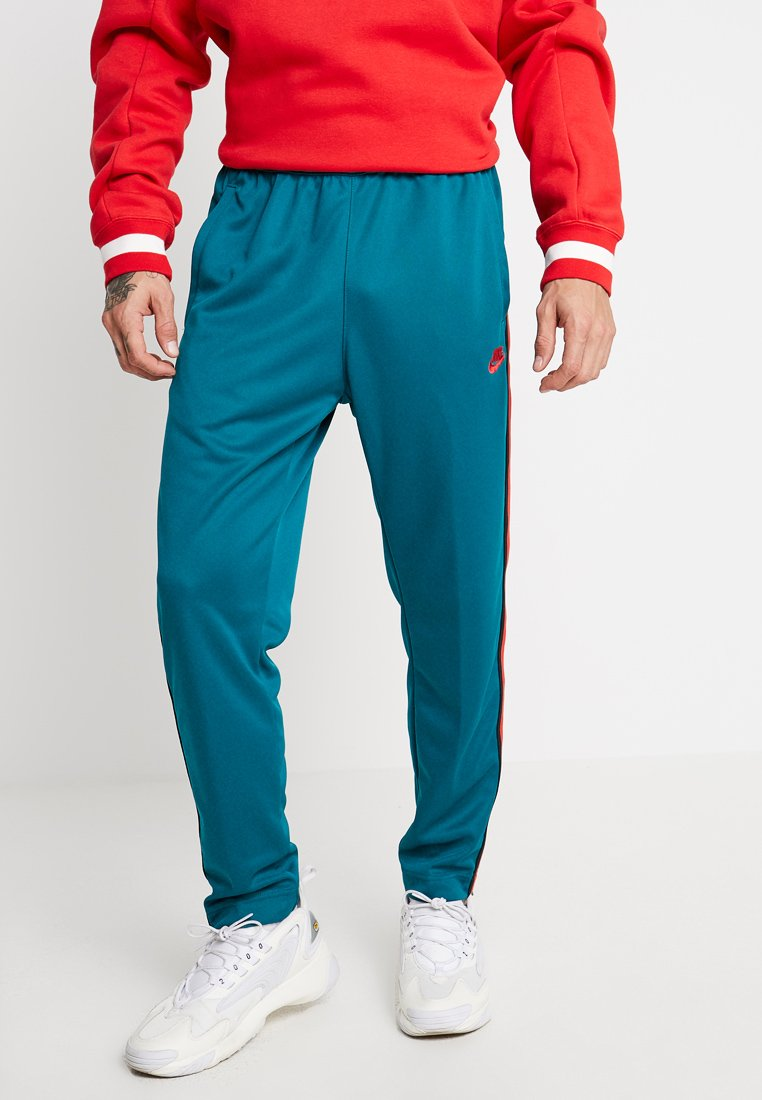 Nike Sportswear - PANT TRIBUTE - Tracksuit bottoms - geode teal/university red