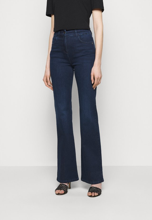 PANTALONI TROUSERS - Jean flare - washed blue