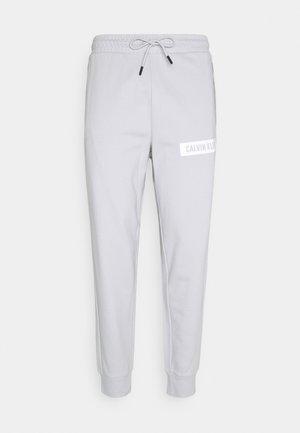 PANT - Tracksuit bottoms - antique grey