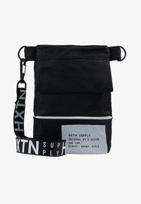 HXTN Supply - PRIME SHOULDER POUCH - Across body bag - black - 6