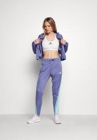 adidas Performance - TEAMSPORT - Verryttelypuku - orbit violet/mint ton - 1