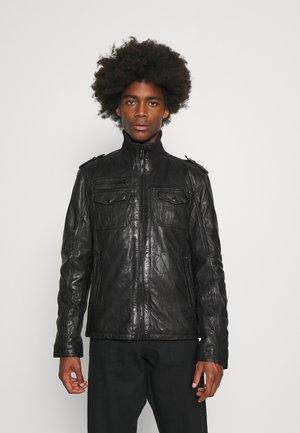 IVANO - Leather jacket - black