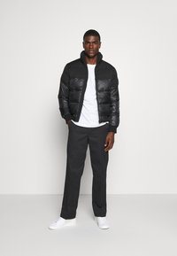 Calvin Klein Jeans - MATTE AND SHINE PUFFER - Winter jacket - black