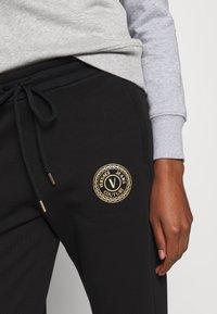 Versace Jeans Couture - PANTS - Tracksuit bottoms - black - 3
