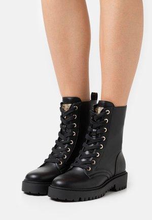 OLINIA - Šněrovací kotníkové boty - black