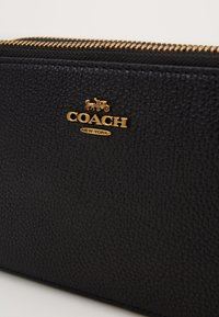 Coach - POLISHED PEBBLE KIRA CROSSBODY - Across body bag - black - 4
