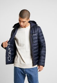 Calvin Klein - HOODED WADDED JACKET - Light jacket - blue - 0