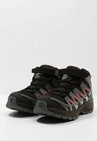 Salomon - XA PRO 3D MID  - Hiking shoes - black/stormy weather/cherry tomato - 3