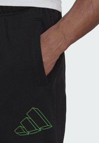 adidas Originals - GRAPHIC - Træningsbukser - black - 3