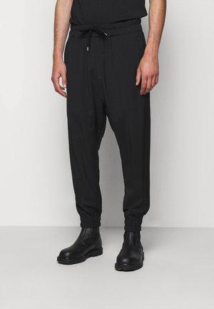 PANTALONE - Trousers - nero