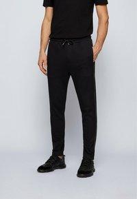 BOSS ATHLEISURE - Pantalon de survêtement - black - 0
