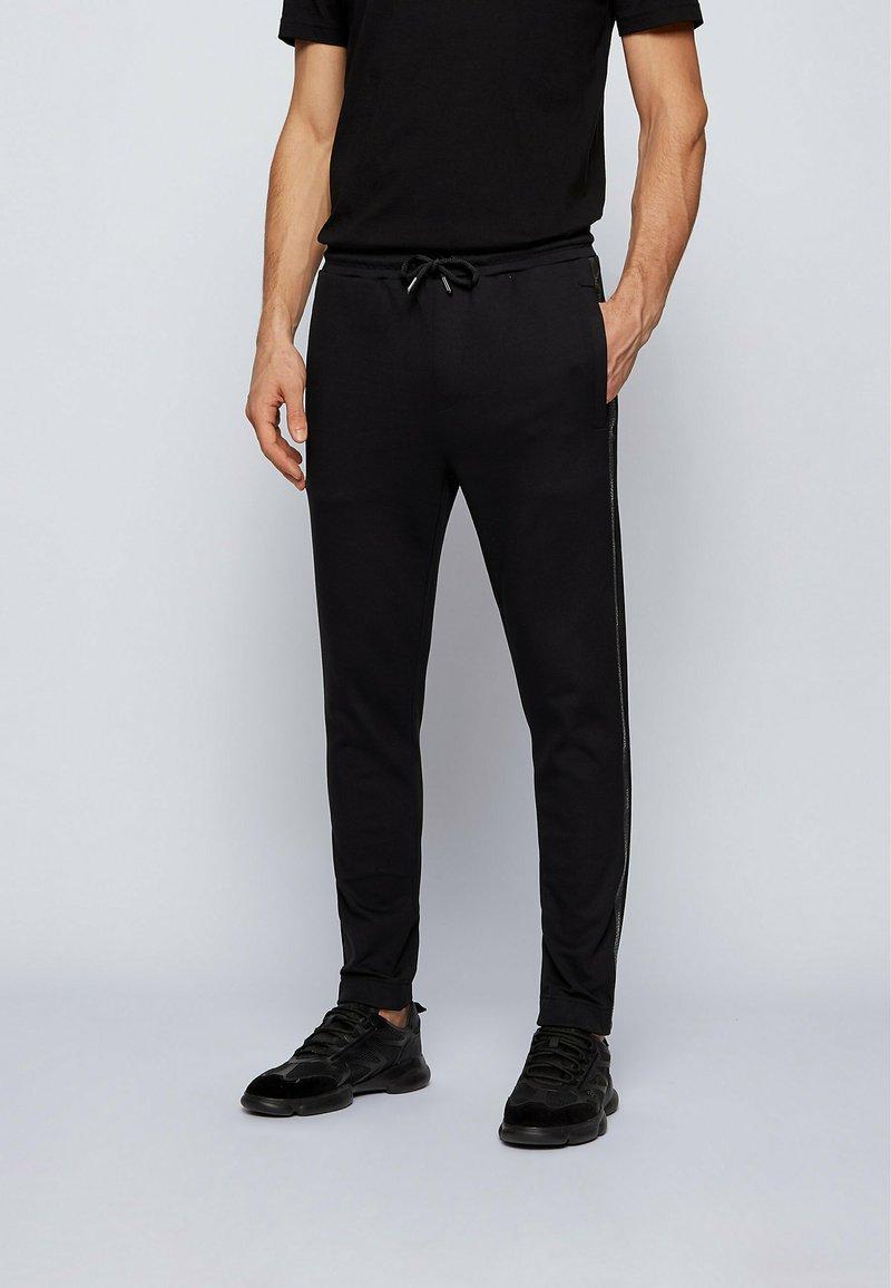 BOSS ATHLEISURE - Pantalon de survêtement - black