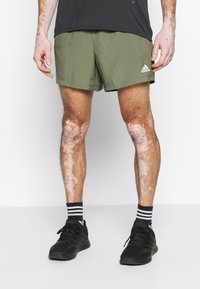 adidas Performance - OWN THE RUN RESPONSE RUNNING  - Sports shorts - green - 0