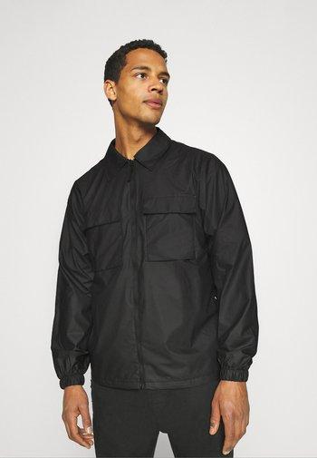 ULTRALIGHT ZIP UNISEX - Summer jacket - black