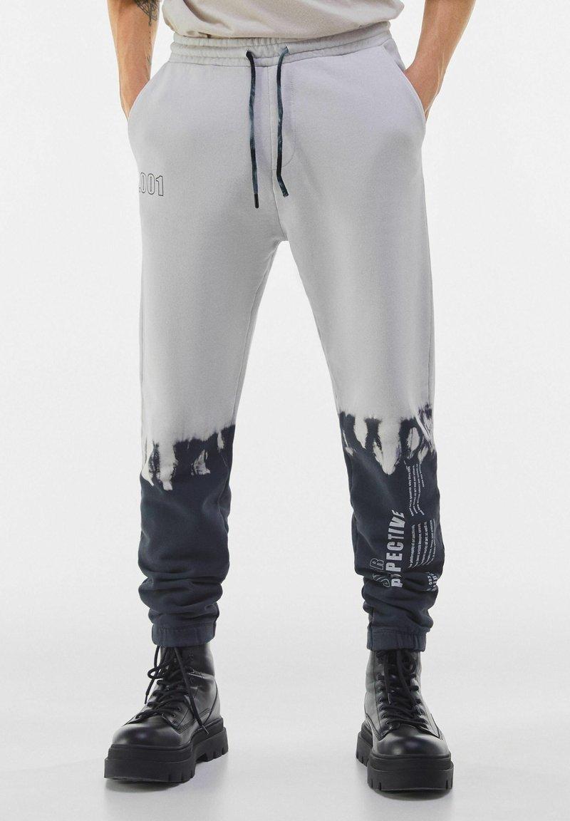 Bershka - Spodnie treningowe - grey
