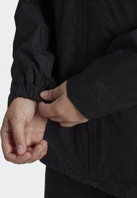 adidas Performance - BSC 3-STRIPES FOUNDATION PRIMEGREEN RAIN.RDY OUTDOOR JACKET - Waterproof jacket - black - 4