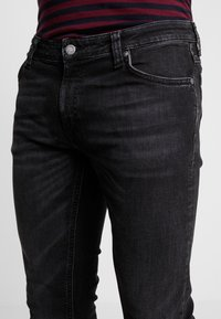 Nudie Jeans - SKINNY LIN - Jeans Skinny Fit - worn black - 5