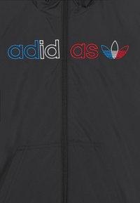 adidas Originals - WINDBREAKER UNISEX - Light jacket - black - 2