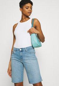 Tommy Jeans - MID RISE - Denim shorts - tess light blue - 3