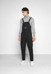Nike Sportswear - OVERALLS - Trousers - black/white - 1