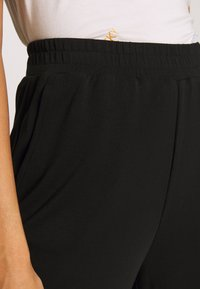 ONLY - ONQGAIA WIDE PANT - Trousers - black - 4