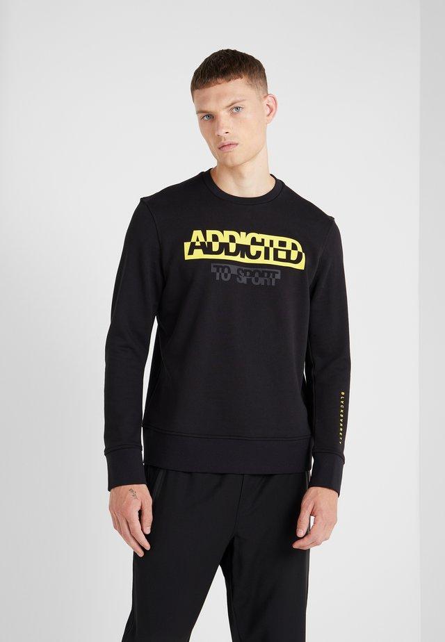 ADDICTED TO SPORT - Sweatshirt - black/yellow