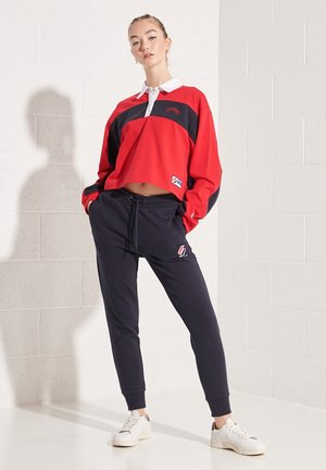 DOLMAN RUGBY - Polo shirt - risk red
