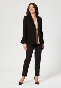 usha - Short coat - black - 1