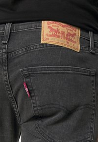 Levi's® - 502™ TAPER HI BALL - Jeans Tapered Fit - black denim - 4