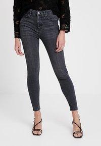 Topshop - JAMIE NEW - Jeans Skinny Fit - black denim - 0
