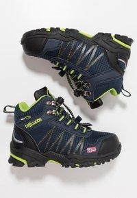 TrollKids - KIDS TROLLTUNGA MID UNISEX - Hiking shoes - navy/viper green - 0