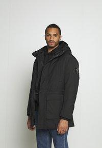 Calvin Klein Jeans - FAKE DOWN TECHNICAL  - Parkatakki - black - 0