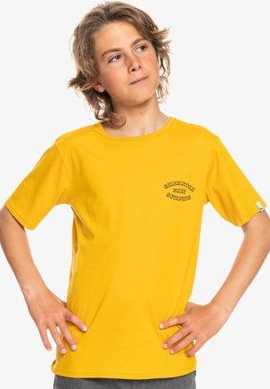 WILD CARD - Print T-shirt - nugget gold