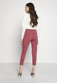ONLY Petite - ONLPOPTRASH EASY COLOUR PANT - Pantalon classique - dark red