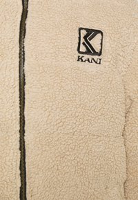 Karl Kani - RETRO PUFFER JACKET UNISEX - Zimní bunda - light sand - 2