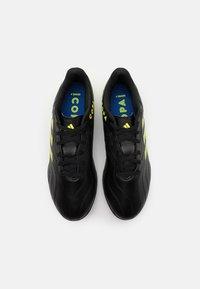 adidas Performance - COPA SENSE.4 TF - Astro turf trainers - core black/solar yellow - 3