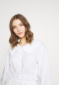 Monki - MILDA BLOUSE - Button-down blouse - white - 4