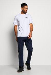 Patagonia - LOGO RESPONSIBILI TEE - Print T-shirt - white - 1