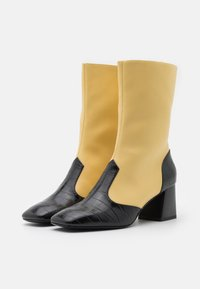 Monki - KEELY BOOT VEGAN - Classic ankle boots - yellow/black - 2